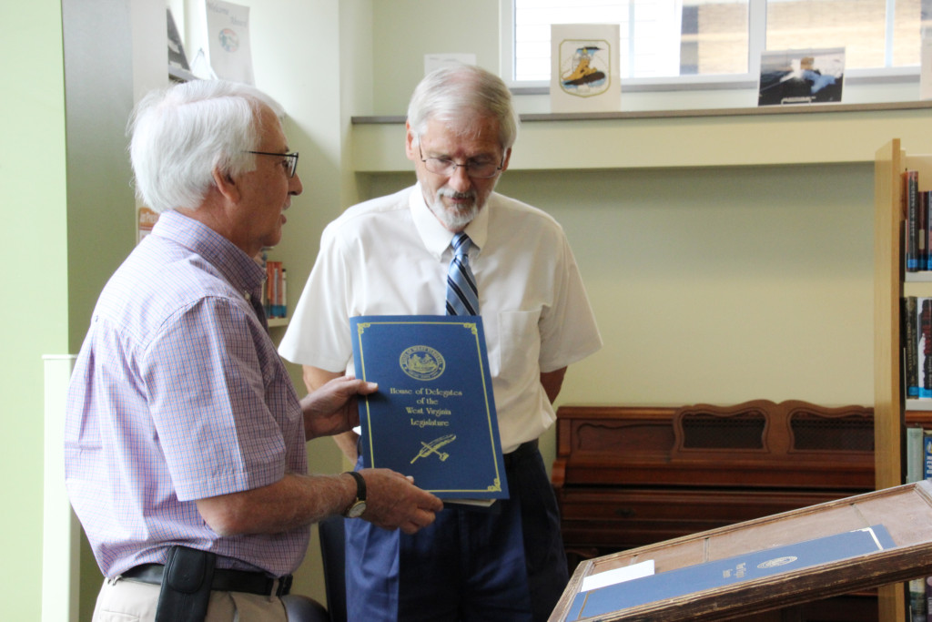 West Virginia State Delegate Walter Duke (R-Berkeley, 61) presents Roger Engle a Legislative Citation from the House of Delegates of the West Virginia Legislature at a ceremony held at Hedgesville Public Library on June 20, 2015 to honor the award-winning, West Virginia author. | Photo by Stephanie Engle