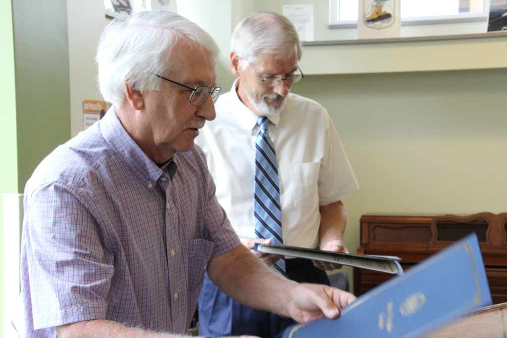 West Virginia State Delegate Walter Duke (R-Berkeley, 61) prepares to read the Certificate of Recognition presented by the Senate of West Virginia to Roger Engle at a ceremony held at Hedgesville Public Library on June 20, 2015 to honor the award-winning, West Virginia author. | Photo by Stephanie Engle