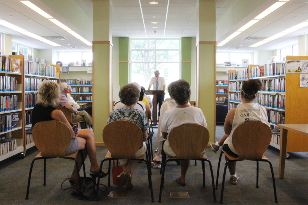 "Roger Engle, award-winning author of ""Stories from a Small Town: Remembering My Childhood in Hedgesville, West Virginia,"" speaks after being recognized by both the Senate of West Virginia and House of Delegates of the West Virginia Legislature at a ceremony held at Hedgesville Public Library on June 20, 2015. 