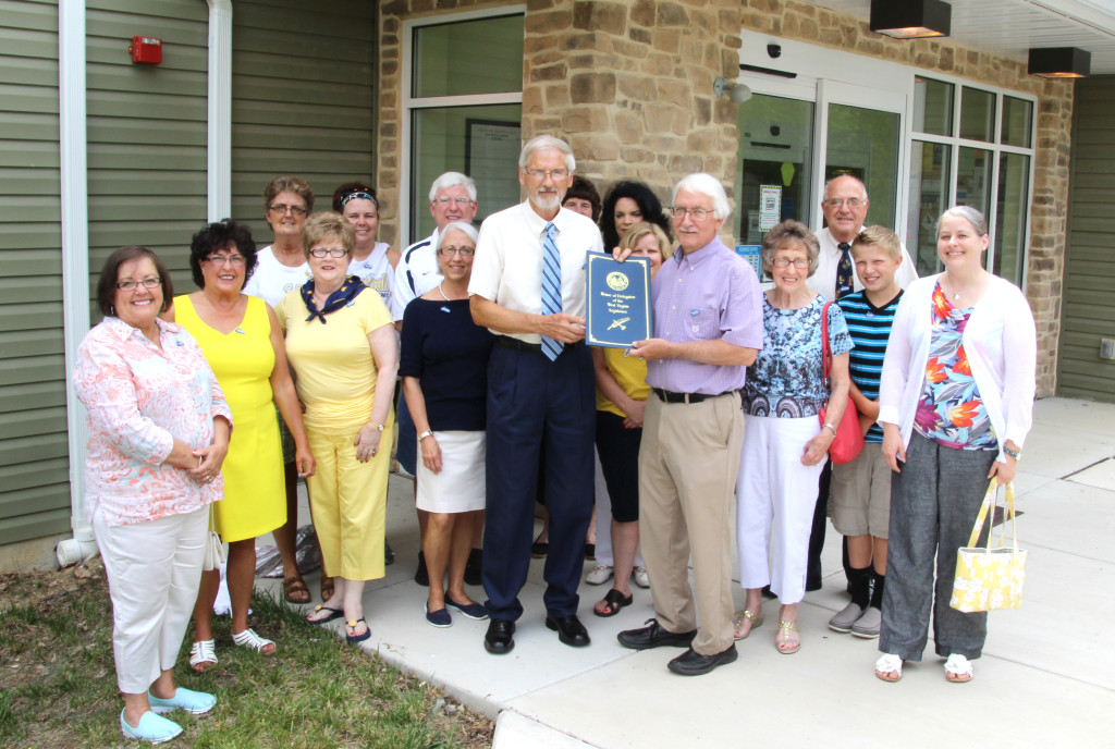 Roger Engle, with West Virginia State Delegate Walter Duke (R-Berkeley, 61) and guests at a ceremony held at Hedgesville Public Library on June 20, 2015 to honor the award-winning, West Virginia author. | Photo by Stephanie Engle