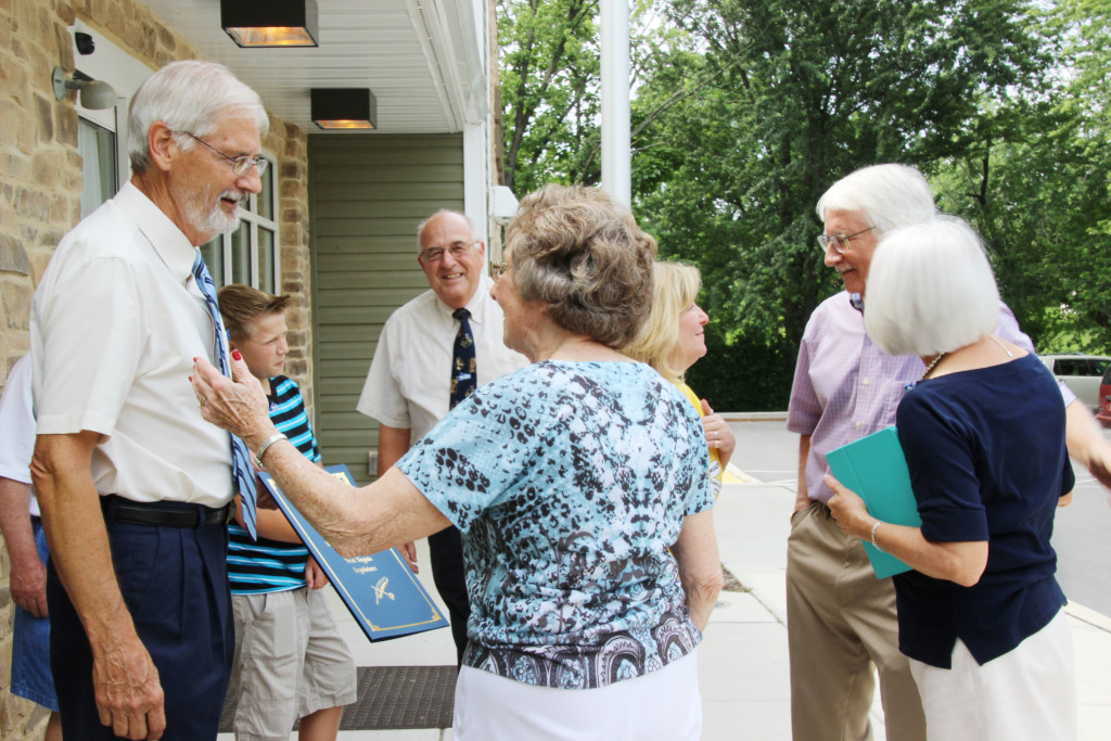 Roger Engle greets friends following a ceremony held at Hedgesville Public Library on June 20, 2015 to honor the award-winning, West Virginia author. | Photo by Stephanie Engle
