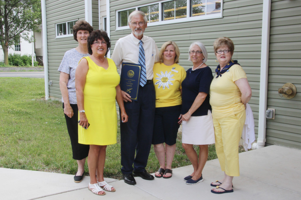 Roger Engle with several members of Main Street Martinsburg, West Virginia, following a ceremony held at Hedgesville Public Library on June 20, 2015 to honor the award-winning, West Virginia author. | Photo by Stephanie Engle